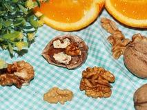 Noix avec des oranges Images stock