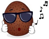 Noix de coco heureuse sifflant avec des lunettes de soleil Photographie stock libre de droits
