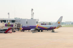 Nok Air passenger plane being serviced at the departure gates of Royalty Free Stock Photo