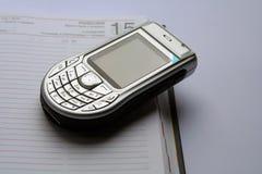 Nokia 6630 and the calendar. Nokia 6630 on the white background Royalty Free Stock Photos
