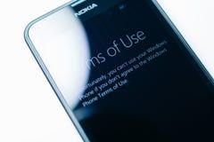 Nokia Lumia Microsoft Widowsphone. LONDON, UNITED KINGDOM - NOVEMBER 9, 2014: Nokia Lumia smartphone windowsphone featuring Terms Of Use on touchscreen display Stock Images