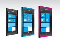 Nokia Lumia Windows Phones in Color. New Nokia smartphone design in blue and pink. Featuring Windows Phone OS, handsets Lumia 800 and Lumia 710 announced Stock Photos