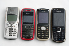 Nokia old mobile phones. Nokia previous models of mobile phones in white background Stock Images
