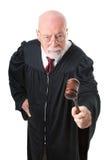 Nol Nonsense Skeptical Judge. No nonsense, skeptical old judge banging his gavel.  Isolated on white Stock Images