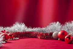Noël rouge Tinsel Background Photographie stock