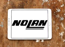 Nolan Helmets manufacturer logo. Logo of Nolan Helmets manufacturer on samsung tablet on wooden background. Nolan Helmets SpA is an Italian motorcycle helmet Stock Photo
