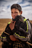 Nomad boy with the young goat, Nomad Valley, Atlas Mountains, Morocco Royalty Free Stock Photos