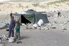 Nomad children in Ladakh, India. Nomad children and tent along the shore of Tso Moriri Lake In Ladakh region in the Indian state of Jammu and Kashmir. The Stock Images
