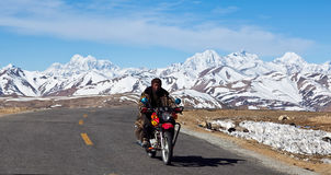 Nomad with motorbike in Ngari, Tibet Stock Photo