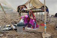 Nomad People in India. December 10,2010 Mandu,Madhya Pradesh,India-A Banjara woman busy for cooking at their temporary shelter Stock Photo