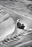 Nomad resting in the Sahara. Stock Photo