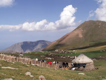 The nomad tent on the mountain slope. In Tien-Shan highlands Stock Images