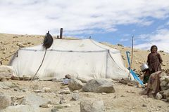 Nomad woman in Ladakh, India. Nomad woman near a tent along the shore of Tso Moriri Lake In Ladakh region in the Indian state of Jammu and Kashmir. The mountain Royalty Free Stock Images