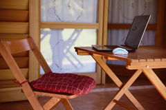 Nomad work concept image with computer on wood table and sunligh Stock Photos