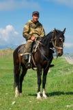 Nomade con il suo cavallo Immagini Stock Libere da Diritti