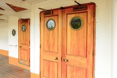 Nomadic (1911), a steamship of the White Star Line. BELFAST, NI - JULY 16, 2016: Door at the SS Nomadic (1911), a steamship of the White Star Line. It was a royalty free stock image