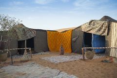 Nomadic tent camp. Berber tent camp in the Moroccan sahara at sunset Royalty Free Stock Images