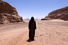 Nomadic woman with burka in wadi rum Royalty Free Stock Photos