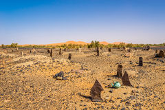 Nomads cemetery in area of Mezouga in Morocco. MERZOUGA, MOROCCO - APRIL 4,2017 - Nomads cemetery in area of Mezouga. A nomad is a member of a community of Stock Photos