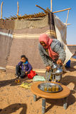 Nomads living in the area of Merzouga - Morocco. MERZOUGA, MOROCCO - APRIL 4,2017 - Nomads living in the area of Merzouga. A nomad is a member of a community of Stock Photo