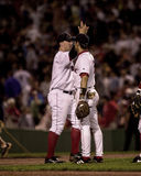 Nomar Garciaparra and Trot Nixon High-Five. Boston Red Sox teammates Nomar Garciaparra and Trot Nixon, high five after a Red Sox win.  (Image taken from a color Royalty Free Stock Images