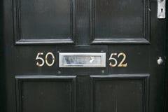Nombre d'adresse dans une porte en bois photos libres de droits