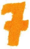 Nombre de lentilles jaunes sur un fond blanc Photos libres de droits