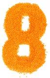 Nombre de lentilles jaunes sur un fond blanc Photographie stock libre de droits