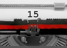 Nombre 15 par la vieille machine à écrire sur le livre blanc Photos libres de droits