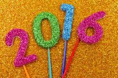 Nombres éclatants formant le numéro 2016, comme nouvelle année Photographie stock libre de droits
