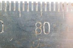 Nombres antiques d'échelles photo stock