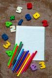 Nombres, carnet, stylos Photos stock