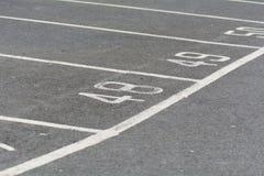 Nombres de l'espace de parking Photographie stock