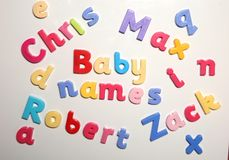 Nombres del bebé deletreados con las letras del alfabeto Imagen de archivo