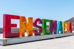 Nome della città di Ensenada nelle lettere variopinte giganti Fotografia Stock Libera da Diritti