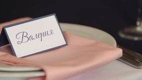 Nominal cards for guests at restaurant interior decoration for wedding or birthday with white and blue colors. Holiday stock footage