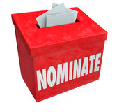 Nominate Candidate Suggestion Box Submit Application Considerati. Nominate word on a red suggestion box to illustrate submitting an application or candidate for Stock Photos