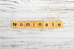 NOMINATE word made with wooden blocks concept royalty free stock image