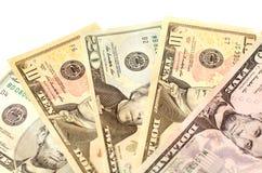 Nominellt värde för dollarräkningar av $ 5 fem, $ 10 tio och $ 20 tjugo Arkivfoto