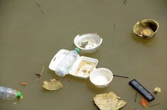 Non-biodegradable waste in water source. Stock Images