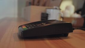 Non-cash transaction. Credit card payment in a shop. Close up photo of woman hand paying with credit card stock footage