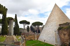 Non-Catholic Cemetery in Rome. Non-Catholic Cemetery and Pyramid of Cestius  tomb for Gaius Cestius , ancient pyramid in Rome, Italy royalty free stock images