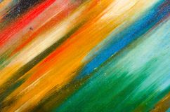 Non-cautious large smears of watercolor paint on canvas. Red, green, blue and orange Royalty Free Stock Photography