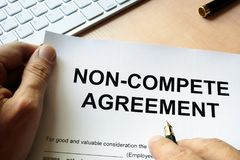 Non compete agreement. Man is signing Non compete agreement Royalty Free Stock Images