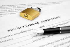 Non disclosure agreement. With lock and pen Royalty Free Stock Images
