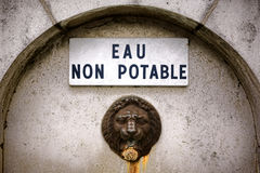 Non Drinkable Water Old Fountain Sign in French Royalty Free Stock Photo