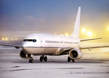 Non-flying weather. Airport and white plane at non-flying weather, winter time Stock Photo