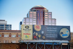 Non-GMO Advertisement Billboard Downtown Portland Oregon. PORTLAND, OR - FEBRUARY 2, 2016: Billboard in downtown PDX advertising non-GMO hummus from Boar's Head Royalty Free Stock Photo
