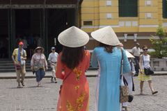 Two girls with Non La traditional Vietnamese hats Royalty Free Stock Photos
