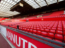 Non Match Day at Manchester United West Stand. Empty seats on a non-match day at the Stretford End or the West Stand in Old Trafford Stadium, home of Manchester Stock Image
